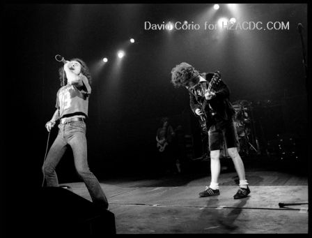 Bon Scott (l) and Angus Young (r) of AC/DC at Hammersmith Odeon, London 1981