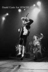 Bon Scott (r) and Angus Young (l) of AC/DC at Hammersmith Odeon, London 1981
